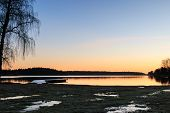 Swedish landscape with jetty, beach and water during dawn sunrise