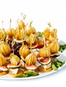 Canapes With Physalis, Fig, Cheese And Crackers
