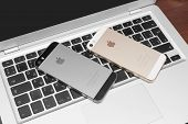 Iphone 5S Gold On Silver Laptop