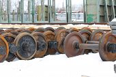stock photo of railcar  - Railcar wheels on the axles of the wheelset as the element - JPG