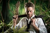 image of machete  - Attractive confident businessman with machete walking in the jungle - JPG