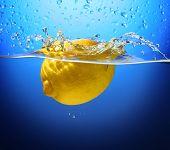 Yellow Lemon In Water Splash