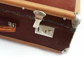Vintage suitcase on white background
