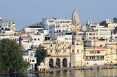 indian people enjoying beautiful view of Pichola lake and palaces at embankment of Udaipur city