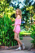 Blonde Woman Posing In Pink Dress