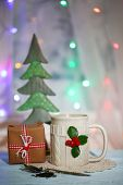 Christmas composition with cup of hot drink, on wooden table