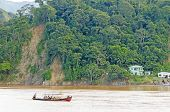 RURRENABAQUE, BOLIVIA, MAY 10, 2014 - Local people travel in traditional wooden boats on Beni river