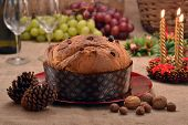 Christmas panettone and ingredients on rustic ambient.