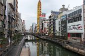 OSAKA, JAPAN - DECEMBER 1, 2014: An ancient canal runs through the Soemon-cho area of Osaka city. The old waterways is still an important mode of transportation in this bustling modern city.
