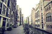 Amsterdam, Netherlands.-APRIL 23: Traditional old buildings on April 23, 2014. Beautiful street view of Traditional old buildings in Amsterdam, the Netherlands