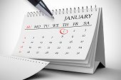 Composite image of january on calendar against white background with vignette