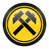 mining icon, yellow logo,