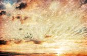 grunge image of sunset sky with clouds