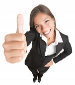 stock photo of business success  - Success woman isolated giving thumbs up sign - JPG