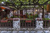 Open-air restaurant in early morning at ancient Melnik town