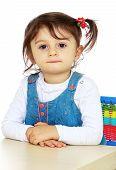 Little girl for interesting occupation.