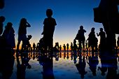 People Reflections On Colorful Sunset