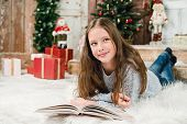 Young girl in Christmas background