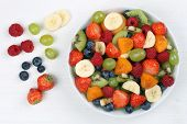 pic of apricot  - Fruit salad with fruits like strawberries blueberries kiwi and apricots from above - JPG