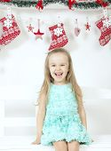 funny little girl with christmas decorations