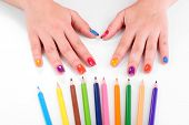 Multicolor female manicure with colored pencils isolated on white