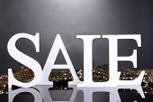 Sale on grey background