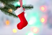 Christmas handmade decorations hanging on Christmas tree on blurred background