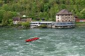 Waterfall Rhine Falls (rheinfall) At Schaffhausen In Switzerland. The Largest Waterfall In Europe