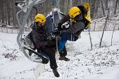 SOCHI, RUSSIA - DECEMBER 12, 2013: Rescuers rehearse rescue on the ski lift. Mountain resort