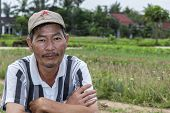 Vietnamese Gardener Looks Into The Camera.