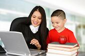 pic of schoolboys  - Schoolboy and teacher looking at laptop in class - JPG