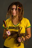 image of dreadlocks  - portrait of a beautiful young woman with dreadlocks on a gray background - JPG