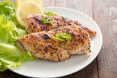 picture of bast  - Marinated grilled chicken breasts cooked BBQ and served with fresh herbs and lemon.