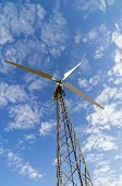image of mast  - Mast with wind power generator against the sky view from below - JPG