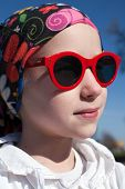 stock photo of cheater  - closeup portrait of young girl in bandana and big sunglasses - JPG