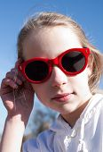 picture of cheater  - closeup portrait of cool young girl in big sunglasses - JPG