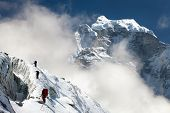 image of nepali  - group of climbers on mountains montage to mounts Kangtega and Thamserku Everest area Khumbu valley Nepal - JPG