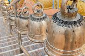 pic of stairway  - row of alloy bell on the stairway in asian temple - JPG