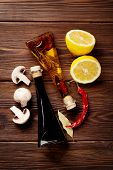 stock photo of condiment  - Various spices and condiments on wooden background - JPG