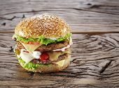 stock photo of hamburger-steak  - Hamburger on old wooden table - JPG