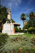 picture of senora  - Bandstand and religious monument in the gardens in front of the Parish of our Lady of the Assumption church  - JPG