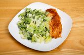 picture of caesar salad  - Baked salmon on square plate with caesar salad - JPG