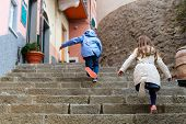 pic of upstairs  - Kids running upstairs at street of colorful Manarola village - JPG