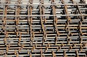 stock photo of reinforcing  - dark reinforcing steel bars for building armature - JPG