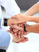 picture of helping others  - Closeup of business team putting their hands on top of each other - JPG