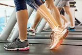 picture of treadmill  - Digital composite of Highlighted ankle of woman on treadmill - JPG