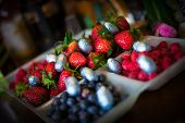 picture of picking tray  - A selection of berries at Easter on a dining table with mini easter eggs dotted about - JPG
