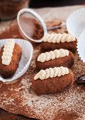 stock photo of cake-ball  - Chocolate rum balls cakes decorated with cream and cocoa - JPG