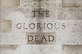 stock photo of glorious  - The Glorious Dead inscription on the Cenotaph War Memorial located on Whitehall in London - JPG