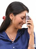 Happy smiling girl blushing with cell phone